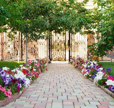 Brick Pavers With Landscaped Flower Beds